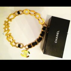 Authentic vintage chanel chain necklace / belt Authentic vintage Chanel necklace/ belt, gold chain with black leather throughout. Coco Chanel with letters approximately 2 inches measuring 33 inches from end to end , great condition no peeling or loose ends, slight superficial scratches barely noticeable and probably can be buffed out, comes with original dust bag and box. Amazing statement piece. CHANEL Accessories Belts
