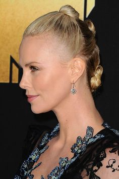 Charlize Theron's multi-buns Get ready for the multi-buns revival, this 90s inspired hairstyle is back and set to take over the summer. Charlize put a glam spin on the sporty look last night by keeping her hair super slicked and ultra glossy.