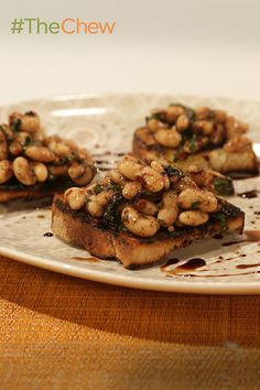 This delicious White Bean Bruschetta is the perfect appetizer for impressing your party guests!