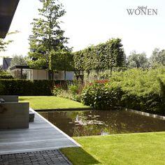 Stijlvol Wonen: het magazine voor warm-hedendaags wonen - ontwerp: De Rooy Hoveniers - fotografie: Sarah Van Hove, Dorien Ceulemans, Jonah Samyn #outdoor #tuin #vijver #terras #hout #dek