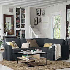 charcoal sectional, floor mirror, natural woven area rug. I like the colors and the casual feel.
