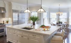 Custom Kitchen with painted cabinets and Carrara marble countertops by Liliane Hart Interiors - Lookbook - Dering Hall