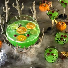 Slimy Lime Fruit Punch (Halloween Potion) -   For the punch, combine powdered lemonade mix (enough to make 2 quarts) with 1/4 cup sugar and 1 teaspoon meringue powder in a large punch bowl. Whisking briskly, add 2 liters of seltzer water, followed by 10 drops green food coloring and 4 drops yellow food coloring. Add a peeled and sliced orange, a sliced lime and 1 pint raspberries for color. Cackle maniacally and serve.