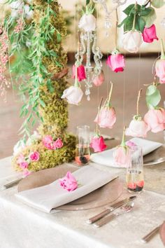 Roses suspended over a wedding reception table | Anna Markley