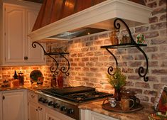 Love the brick, vent hood and cabinets