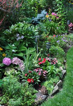 Add some interest to the edges of your flowerbeds.  Stones mark and elevate the  the flowerbeds and...