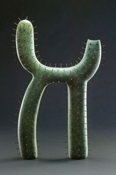 Cactus Cat by John Buck. Bronze with steel pins.