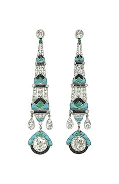 A PAIR OF DIAMOND AND MULTI-GEM EAR PENDANTS Each suspending a three-panel tapered pendant, set with rose-cut diamonds, enhanced by turquoise, emerald and onyx detail to the similarly-set old-cut diamond terminal, drop-shaped pampilles and collet-set diamond surmount, 3 ins., mounted in platinum