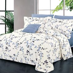 Perfect in cozy cottage getaways and modern lofts alike, this duvet cover set showcases a scrolling floral print in a soothing palette.