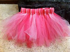 DIY tutu. This is one of new favorites. It was so easy and they turned out perfectly! I used one 25 yard spool of matte Tulle and one 12 yard spool of glitter Tulle and tied two strands of matte and then one of the glitter. If you don't like mess, don't use the glitter Tulle. It gets on everything!!!