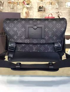 Louis Vuitton Monogram Eclipse Messenger PM Voyager M40511.  See details at http://www.luxtime.su/louis-vuitton-monogram-eclipse-messenger-pm-voyager-m40511