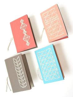 How to make small notebooks covered in decorative stitching.
