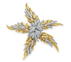 A DIAMOND AND GOLD 'FLAME' BROOCH, BY JEAN SCHLUMBERGER, TIFFANY & CO.