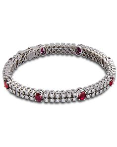 77ab5d9666784 8 oval rubies set with round brilliant cut diamonds in 18 karat white gold.8