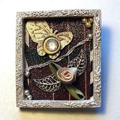 """Wearable Art Brooch Pin Framed - original design IMMEMORIAL-""""The skies they were ashen and sober, The leaves they were crisped and sere - The leaves they were withering and sere, It was night in the lonesome October, Of my most immemorial year"""" -Edgar Allen Poe  1-of-A-Kind Tiny Collage created by me, Signed & dated-title on back-turned into Wearable Art.  Measures 2"""" x 2"""" on cardstock w/paper, satin flower, silver beads & chain, gold sparkly butterfly, watch parts, ribbon & frame.  Black…"""