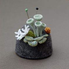 crocheted fungus and lichen pincushion by elin thomas
