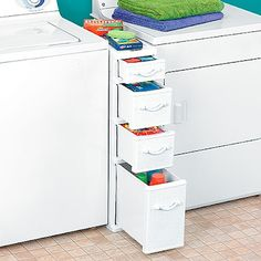 Using up every bit of space in your laundry room, even the space between the washer and dryer with this wicker storage system. Brilliant!