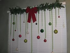 Use this for just an idea. Use a tension rod to hang ornaments from. Wait... I can add my snowflakes, lights and more.