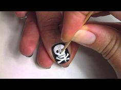 nail art -- video tutorial -- how to paint a skull and crossbones