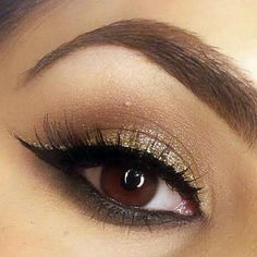 Natural eyeshadow paired w/black winged & gold glitter eyeliner- must try!