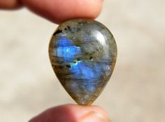 Check out this item in my Etsy shop https://www.etsy.com/listing/232547601/blue-flash-labradorite-cabochon-natural