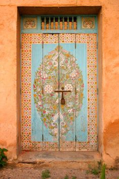 Beautiful painted decorative  orange and blue door.