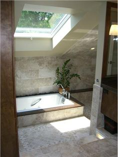 The natural light flooding in from the skylight combined with multiple light fixtures offers an outdoor, spa-like feel.