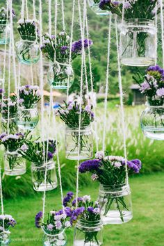 purple flowers filled in mason jars - Outdoor destination wedding Thailand | sodazzling.com | Photography : luvverly.com