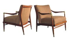 a sculpted pair of Danish modern 1960's brass accented lounge chairs; attributed to Ib Kofod-Larsen
