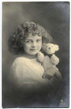 Vintage postcard. Girl with teddy bear