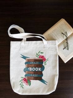 Send a positive message and promote reading by proudly carrying around this exquisite tote bag. Cotton Tote Bags, Reusable Tote Bags, Best Tote Bags, Youre Crazy, Gifts For Readers, Positive Messages, Book Lovers Gifts, Womens Tote Bags, Book Worms