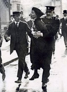 Suffragette (women's rights movement) Emmeline Pankhurst being arrested after protesting near Buckingham Palace. London, England, [1907-1914].