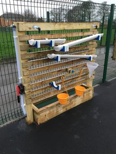 Water Play - Water Wall with Adjustable Water Troughs, Scales and Funnel.
