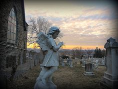 A stone angel in profile at St. Mary's Cemetery, near Roland Park in Baltimore