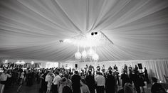 Tent decor.  Tent & Rentals: Snyder Event Rentals;  Tent Fabric Installation: Blossoms Events;  Flowers, Lighting, Decor: Gathering Floral and Event Design