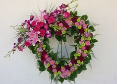 Gorgeous Pink Open Heart Funeral Wreath.  Pink Stargazer Lilies, Fuschia Bombay Dendrobium Orchids, Burgandy Carnations, Green Kermit Poms and Light Pink Aster.
