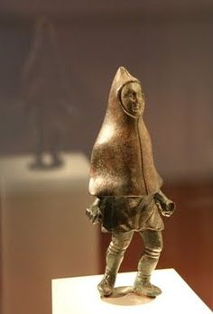 Another view of the statuette of a Trevari man in a hood like a cucullus. Landesmuseum Trier.