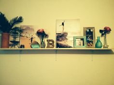 Shelf decor boho vintage girly beachy. Used canvas vases and plants I pull this look together