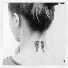 angel wings tattoos on neck