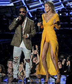 Dance moves: Miguel spoke onstage as Gigi danced around a bit...