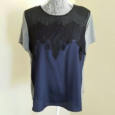 Mixed Media Top This top features a mix of colored fabric (black, navy blue, gray) and lace, zipper detail on the upper back. Woven is 100% polyester, knit is 65% polyester and 35%rayon. Hand was cold. Pre-loved and in excellent condition. Apt. 9 Tops Tees - Short Sleeve