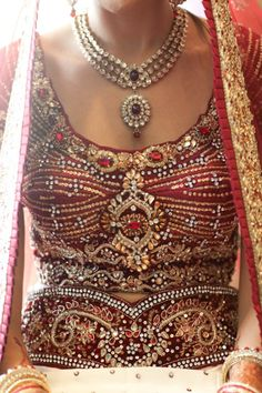 red bridal lengha  see more inspiration @ http://www.ModernRani.com - like the necklace and the the blouse