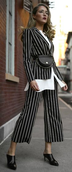 Click for Outfit Details! // Black and white stripe jumpsuit pant, coordinating black and white stripe blazer, white poplin button down shirt, black low heeled mules, black belt bag with stud detail {Veronica Beard, See by Chloe, Stuart Weitzman, Garrett Leight, Tibi, creative workwear, coordinating suit, professional outfits, business style, fashion blogger, trendy, classic}
