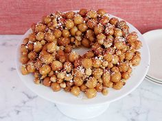 Cicerchata or Struffoli.   This is Giada's recipe and is very good.  I am not a huge fan of hers but this one works very well.  Toss with cranberries and pistachios(shelled and skinned) at Christmas to make it very festive looking.