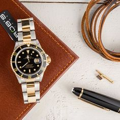 Take a look at these beautiful two-tone Subs | Rolex Submariner | Bob's Watches | #Rolex #Submariner #Twotone #BobsWatches