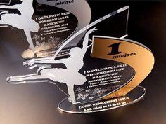 Oryginalne statuetki na Ogólnopolski Konkurs Tańca Baletowego, zostały wykonane z pleksi przezroczystego grawerowanego jednostronnie,laminatu grawerskiego w trzech kolorach: brązowym, srebrnym i złotym – adekwatnie do zajętego  miejsca na podium.