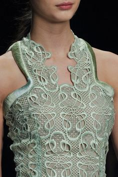 design and texture both add interest. Very unique and wearable piece, and those are two qualities that do not often meet.