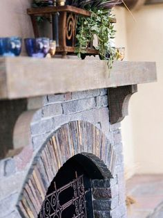Fireside Ambience..The outdoor dining area features a gas fireplace with a stone-and-stucco surround and a fir mantel. The raised hearth continues to either side, forming a built-in bench.