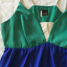 ♥️HP♥️Urban Outfitters Tunic Dress In like new condition.  Beautiful emerald green and cobalt blue with light grey accents.  100% polyester, has a light silky feel.  Measures 14in across the empire waist (has very slight stretch at waist), skirt is 21.5 inches long measured from waist. Urban Outfitters Dresses Mini