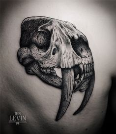 Ien Levin: Electric Tattooing: Amazing animals skull tattoo with large teeth